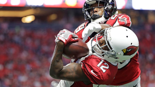Arizona Cardinals wide receiver John Brown (12) makes a touchdown catch ahead of Atlanta Falcons cornerback C.J. Goodwin (29) during the first half of an NFL football game, Saturday, Aug. 26, 2017, in Atlanta.