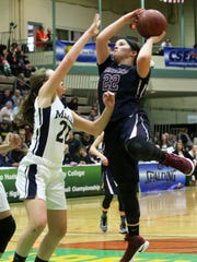 Watkins Glen's Emila Bond drives for two of her team-high 14 points as Mekeel Christian's Jillian Bond defends in the third quarter of Saturday's Class C state semifinal at Hudson Valley Community College. WG won, 60-49.