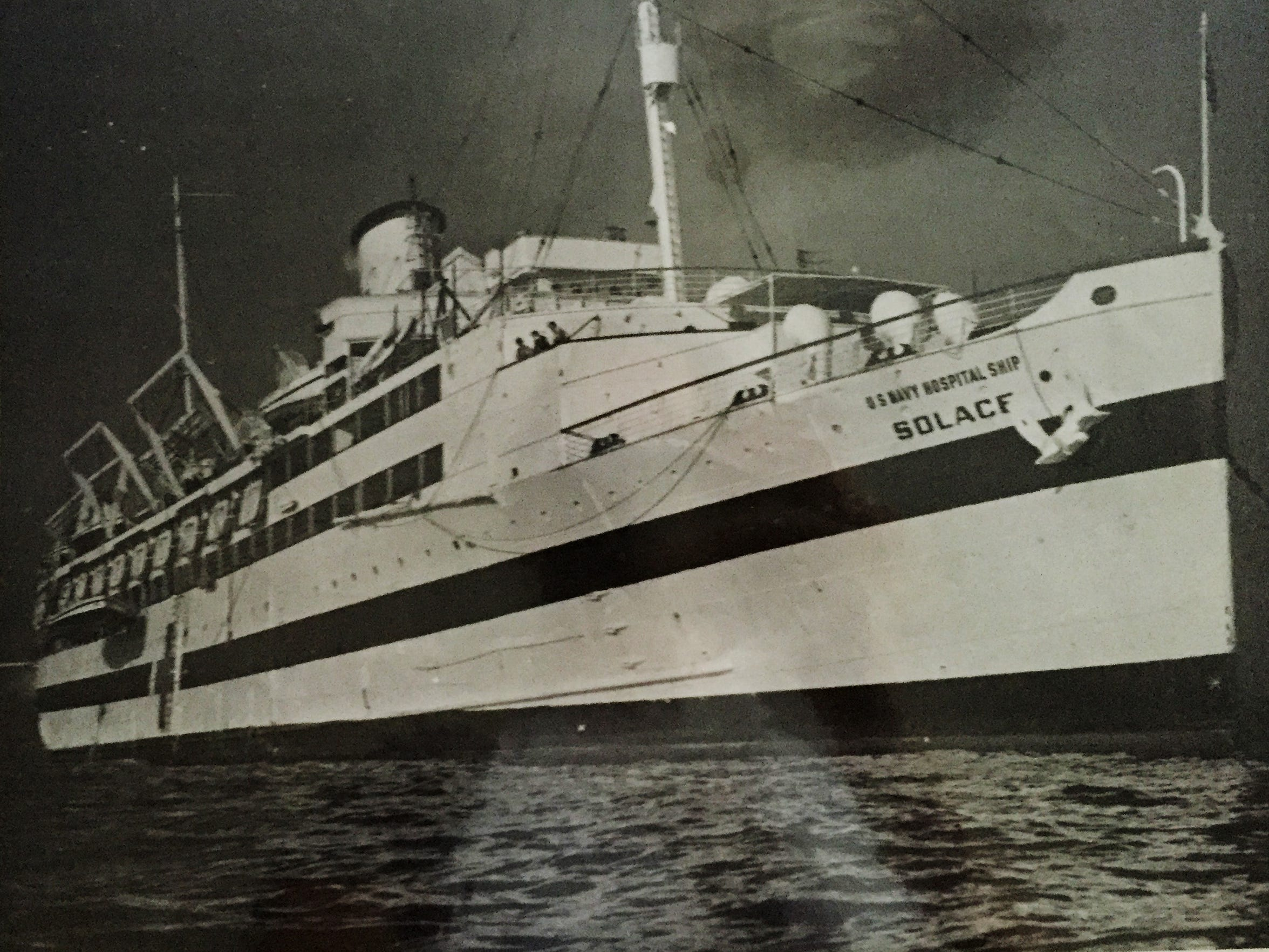Initially, the lighted hospital ship would sail out