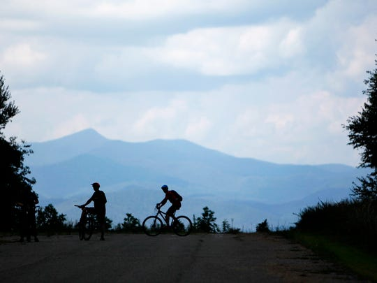 Mountain bikers ride and rest on the airstrip at DuPont