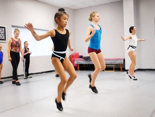 Tap students dance across the room at Center Stage