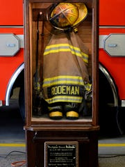 """A memorial for the firefighter Dennis Rodeman was unveiled during a service marking the one-year anniversary of his death at Fire Station #1 in downtown Lansing. Rodeman died after being hit by a vehicle while collecting donations for the """"Fill the Boot"""" campaign."""