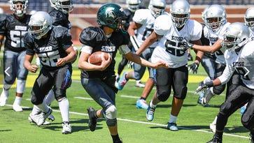 Jim Harbaugh, Michigan football offer scholarship to seventh-grade quarterback
