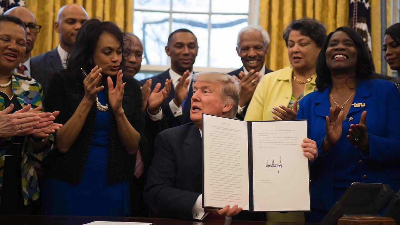 Trump signs wide-ranging bills, executive orders