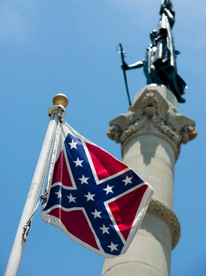 A Confederate flag flies next to the Alabama Confederate Memorial on the grounds of the Alabama Capitol building in Montgomery, Ala., on June 22, 2015.