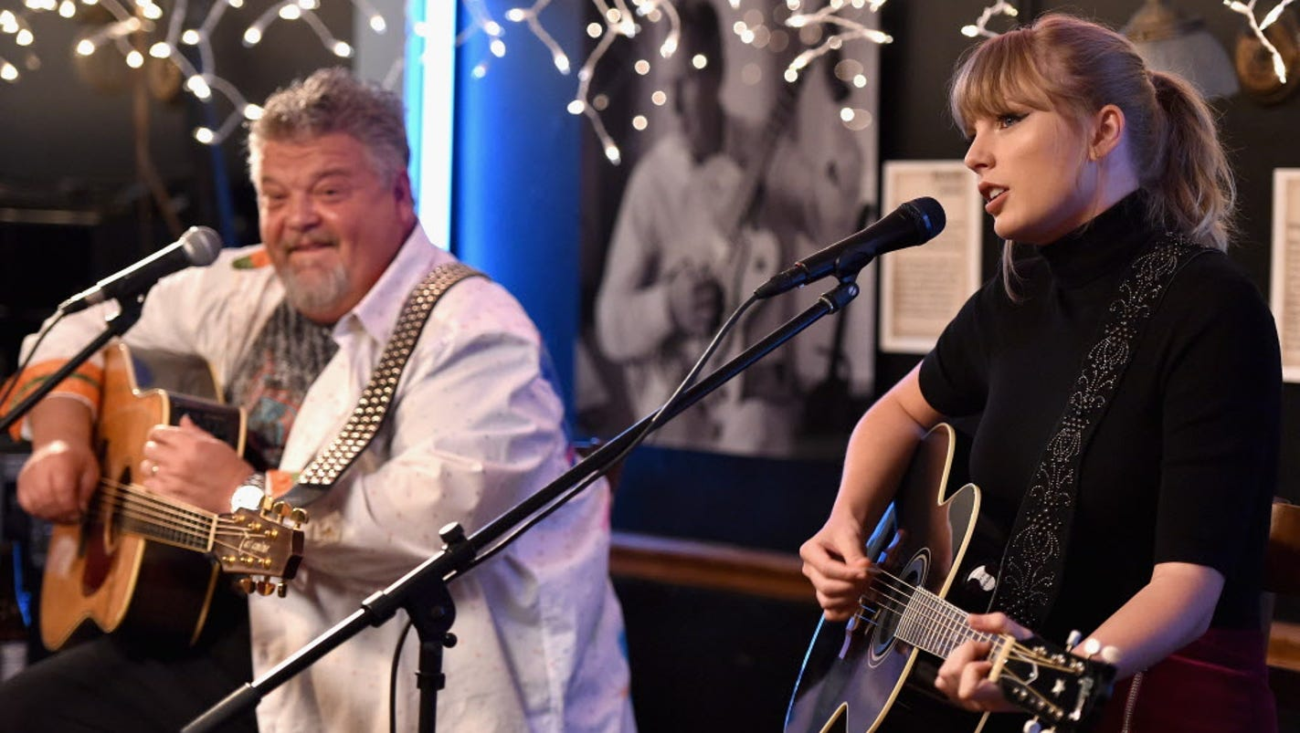 Taylor Swift surprises fans (and shoots whiskey!) at Nashville's Bluebird Cafe