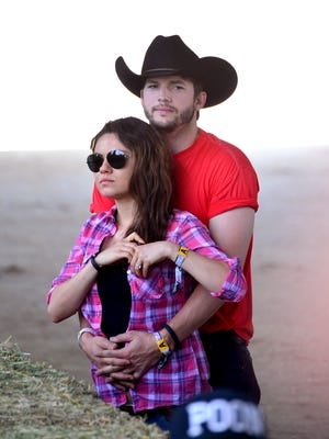 Mila and Ashton on April 25, the first day of  2014 Stagecoach: California's Country Music Festival at the Empire Polo Club in Indio, Calif.