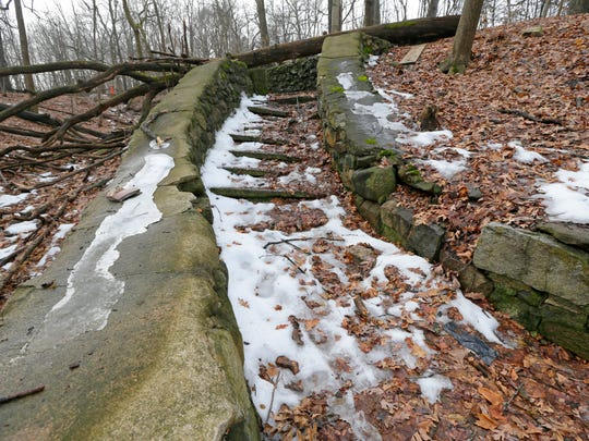 A stone staircase from the old Milwaukee County insane asylum remains on a ravine in an isolated woods of oaks and aspen north of the Ronald McDonald House on Watertown Plank Road.
