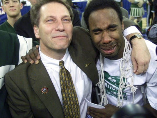 Teary-eyed Spartan coach Tom Izzo stands with an equally teary Mateen Cleaves, as they listen and watch the overhead screen playing the team tribute Monday, April 3, 2000, after the NCAA Championship game against the University of Florida at the RCA Dome in Indianapolis.
