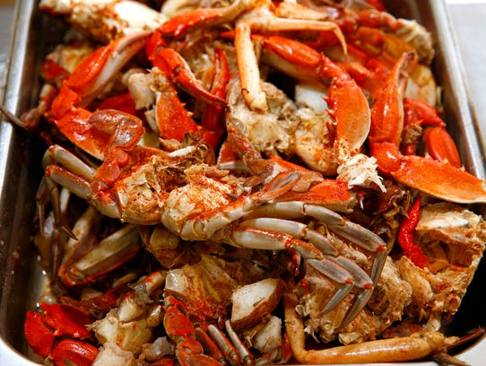 Seasoned crabs are ready to be addede to Mona Morgan's