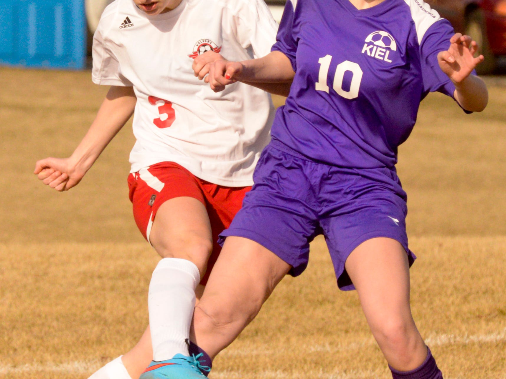 Valders Alyssa Christianson (3) fights for ball control with Kiel's Sophia Heus (10) during Tuesday's nonconference soccer match.