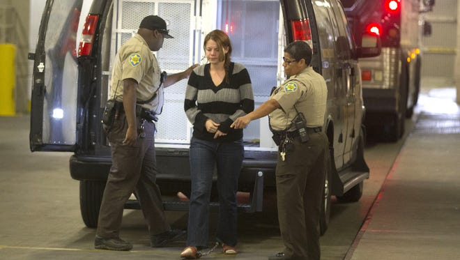 """Elizabeth Johnson arrives at the Fourth Avenue Jail in Phoenix on Thursday, April 7, 2016. Johnson, the mother of missing """"Baby Gabriel,"""" was arrested in New Mexico on suspicion of violating several terms of her probation."""
