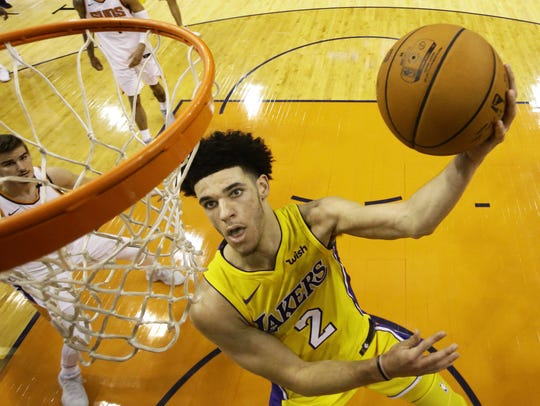 Los Angeles Lakers' Lonzo Ball dives to the basket