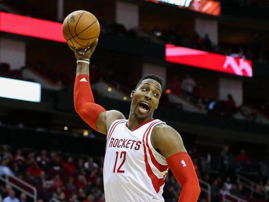 9abe7bbef943 NBA  Atlanta Hawks at Houston Rockets. Houston Rockets center Dwight Howard  ...