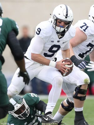 Michigan State's Brandon Randle pressures Penn State's Trace McSorley during the first quarter Nov. 4, 2017 at Spartan Stadium.