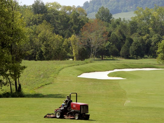Ground crews tend to the fairways in preparation for