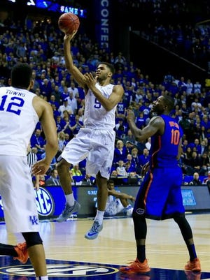 UK's Andrew Harrison floats the ball toward the basket Friday in the Wildcats' 64-49 win over Florida.