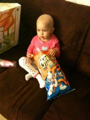 Lyla Hernandez Zavala munches on Cheetos while going