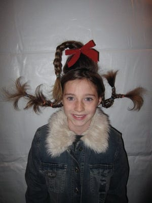 A client from a previous Who-Ville Hair Station event shows off her Cindy -Lou Who styling.