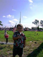Zachary Batten, age 3, at the 2009 Memorial Day ceremony in Naples.