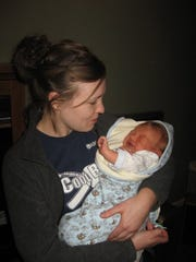 Nora Hertel meets her nephew for the first time in late November 2008, about two weeks after he was born.