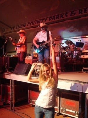 """Laurie K. Blandford dances to """"Redneck Girl"""" by the Bellamy Brothers at the St. Lucie County Fair in 2009."""