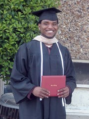 Brandon Johnson at his college graduation in 2009. (handout photo)