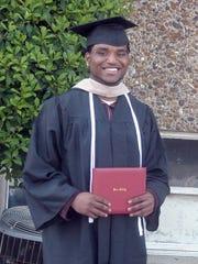 Brandon Johnson at his college graduation in 2009.