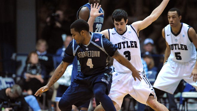 Butler guard Alex Barlow applies defensive pressure to Georgetown guard D'Vauntes Smith-Rivera inside Hinkle Fieldhouse, Saturday, January 11, 2014, in Indianapolis.