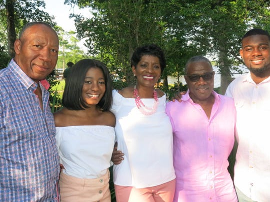 "U.S. Marshal Henry Whitehorn, Shaylen Braggs, Sharon and Lynn Braggs, Christopher Braggs at the annual  ""Sharon & Lynn's Gumbo & Crawfish Boil"" at their north Cross Lake Home,. The yard was filled with friends and lake-side seating."