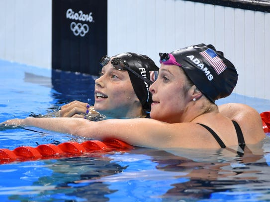 Hali Flickinger, left, greets Cammille Adams (USA)