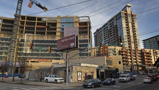 The Station Inn is a little oasis of bluegrass and roots music surrounded by condos and apartments as construction booms in the Gulch.