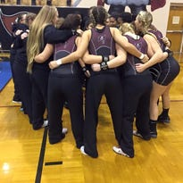 The Navarre Girls weightlifting team huddles before competing in the Region 1-2A finals on Jan.  19.