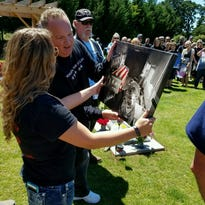 Tribute to Fallen Soldiers Northwest cars flank family of Ty Hart.