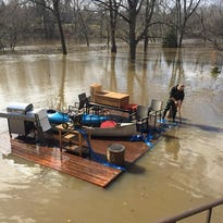 Lansing couple retrieves, ties down deck after it floated into the Grand River