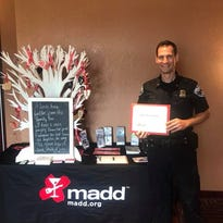 Milford Officer Dan Caldwell receives MADD Lifesaver Award for 2017 arrests