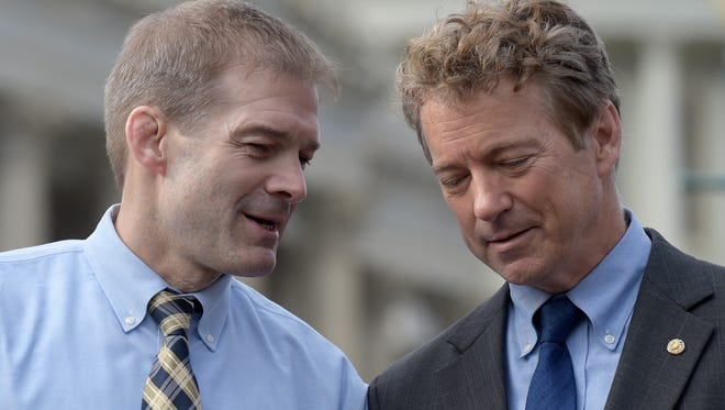 Rep. Jim Jordan, R-Ohio, left, talks with Sen. Rand Paul, R-Ky., during a news conference on health care on Tuesday, March 7, 2017, on Capitol Hill in Washington.