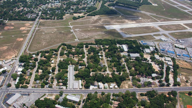 The city approved acquiring seven parcels Thursday among the interior of Tippin and Langley avenues. The parcels will eventually be developed for airport use.