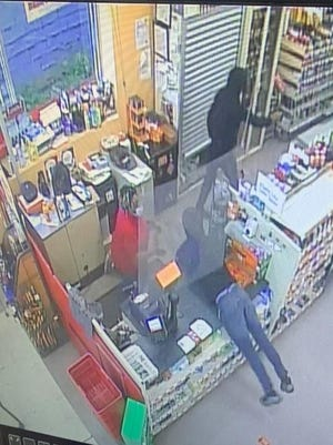 Akron police released this photo of a robbery, and are asking people with information to call detectives.