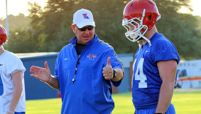 Louisiana Tech coach Skip Holtz, left, said he's working on improving the stability for his assistant coaches, which includes salaries and contracts.