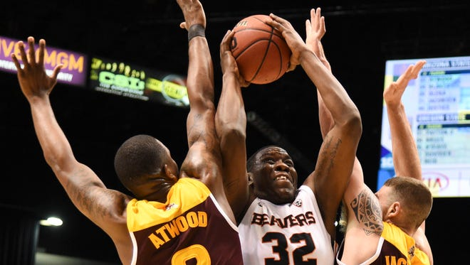 March 9, 2016; Las Vegas, NV, USA; Oregon State forward Jarmal Reid (32) shoots the basketball against Arizona State forwards Willie Atwood (2) and forward Eric Jacobsen (21) during the second half of the Pac-12 Conference tournament at MGM Grand Garden Arena. The Beavers defeated the Sun Devils 75-66.