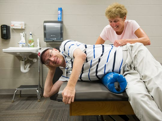 Josh Miller, of Newburgh, works with physical therapist