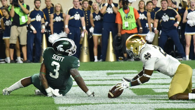 The ball was knocked free just as running back L.J. Scott was about to reach the end zone against Notre Dame on Saturday.