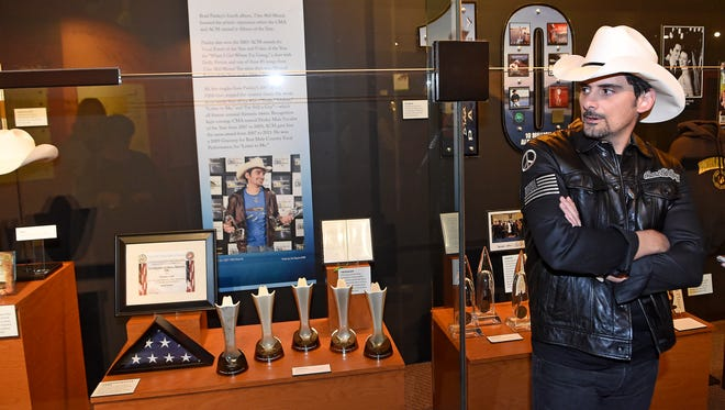 Brad Paisley looks over his new exhibit Thursday, Nov. 17, 2016, at the Country Music Hall of Fame and Museum.