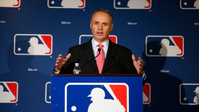 MLB commissioner Rob Manfred addresses the media at a press conference on Monday, Feb. 23, 2015 in Phoenix, AZ.
