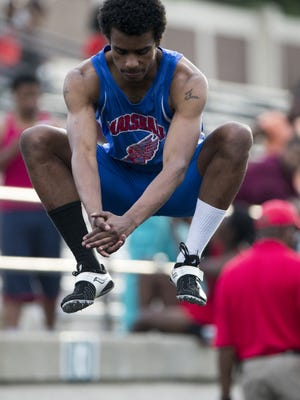Stoney Prowell, a senior at John Marshall, does a few warmup jumps before easily winning the boy's 400 meter run, at Arsenal Tech High School, Indianapolis, Friday, May 8, 2015.