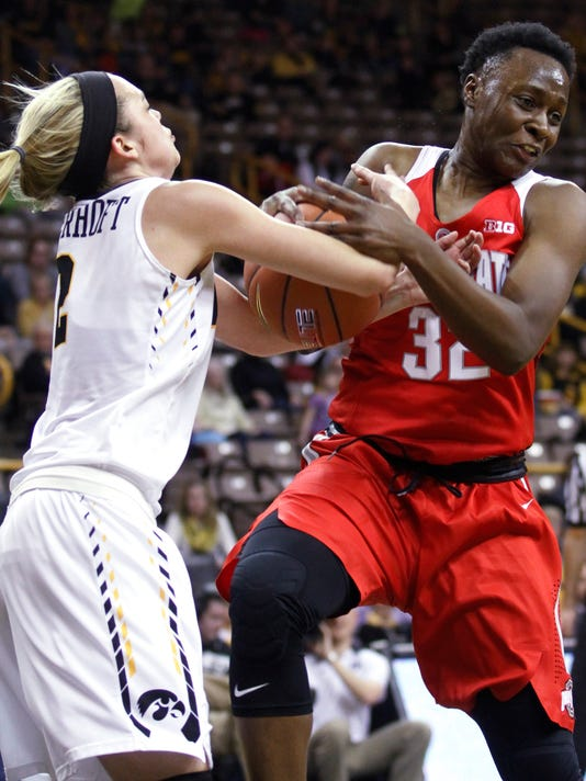 Ohio State forward Shayla Cooper (32) fights for a rebound against Iowa guard Ally Disterhoft during the first half of an NCAA college basketball game in Iowa City, Iowa, Thursday Feb. 11, 2016. (AP Photo/Matthew Holst)