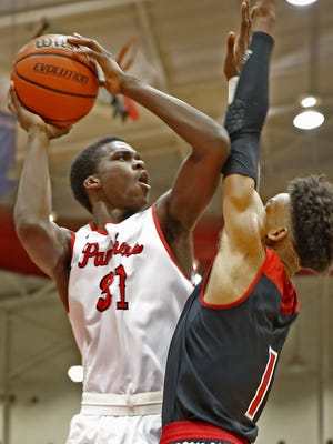 North Central's Kris Wilkes (31) shoots over New Albany's Romeo Langford during Saturday's Tip-Off Forum Classic at Southport.