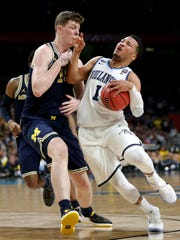 Jon Teske defends Villanova guard Jalen Brunson during the national championship game April 2 at the Alamodome in San Antonio.