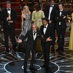 """Michael Keaton (center left), Alejandro G. Inarritu and the cast and crew of """"Birdman or (The Unexpected Virtue of Ignorance)"""" accept the award for the best picture at the Oscars on Sunday, Feb. 22, 2015, at the Dolby Theatre in Los Angeles."""